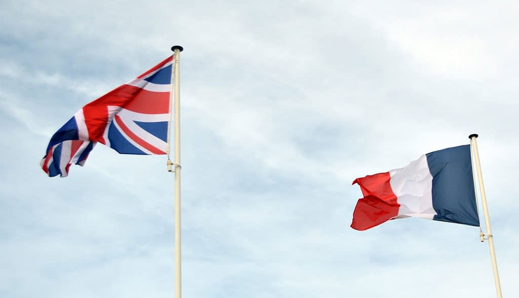england and franch flags on the blue sky